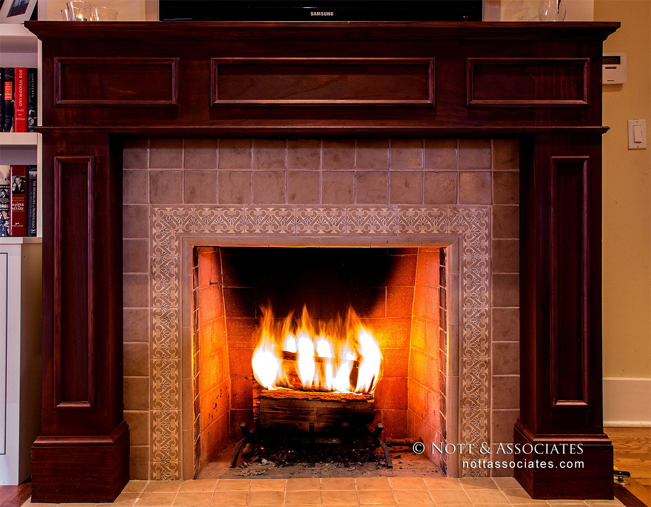 Fireplace with detailed terra cotta.