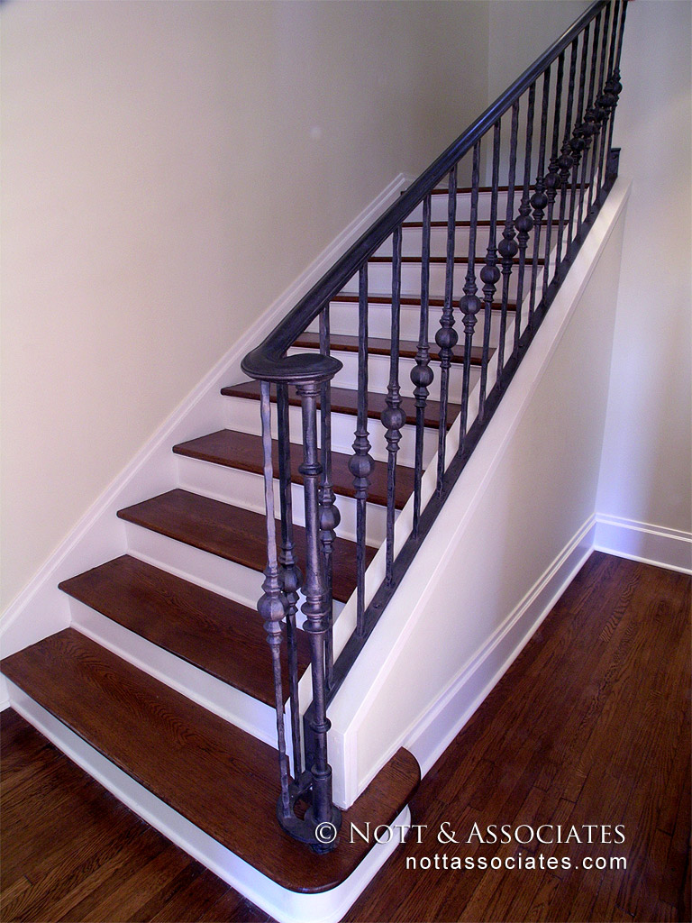 Custom antique steel handrail on staircase in San Marino.