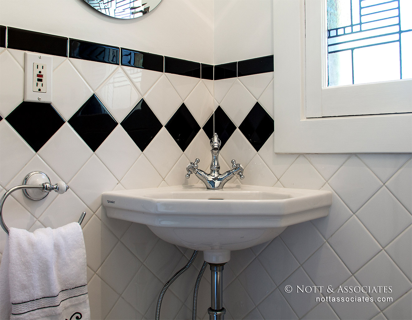 A powder room with period style corner sink