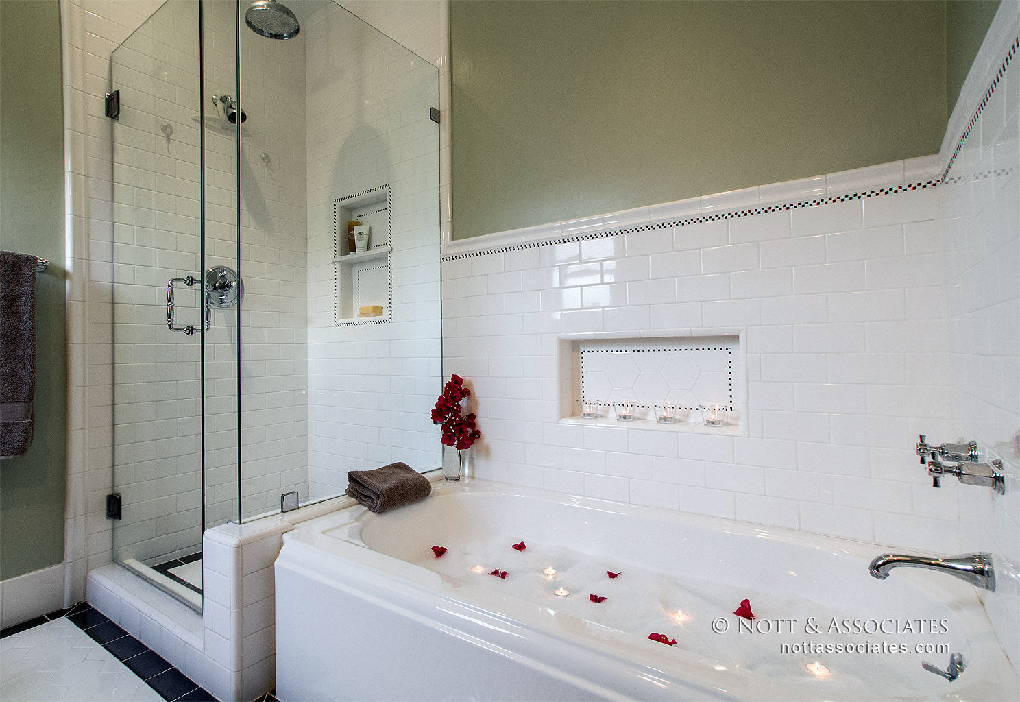 A spa bath with California faucets fixtures and frameless glass shower