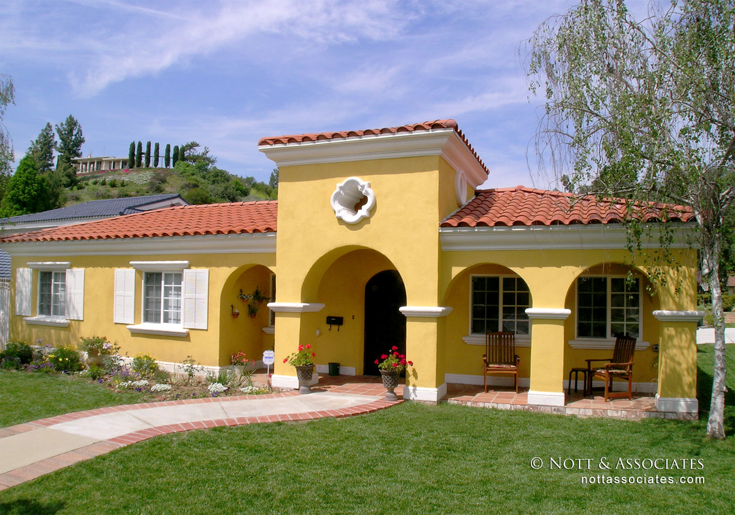 All new entry of remodeled Spanish style home