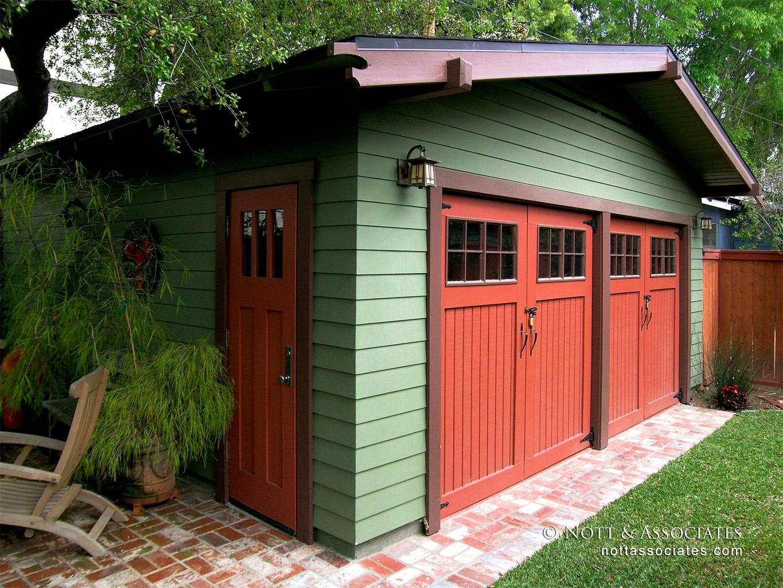 Craftsman revival garage with barn doors.