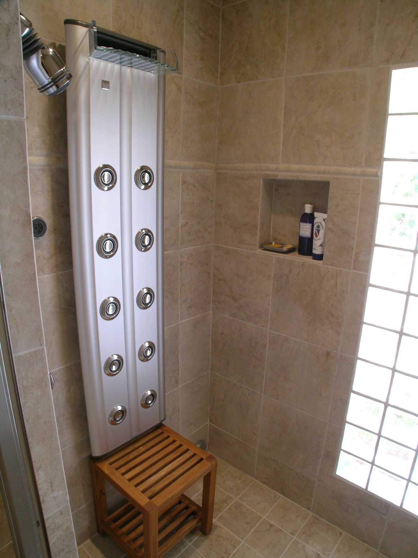 A full shower with waterfall plumbing fixture.