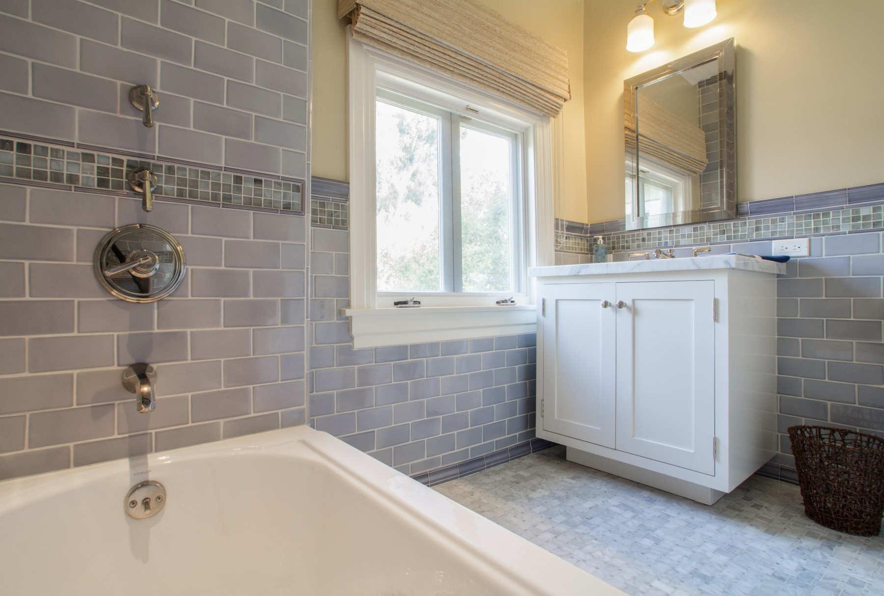 A Craftsman guest bath with modern finishes.