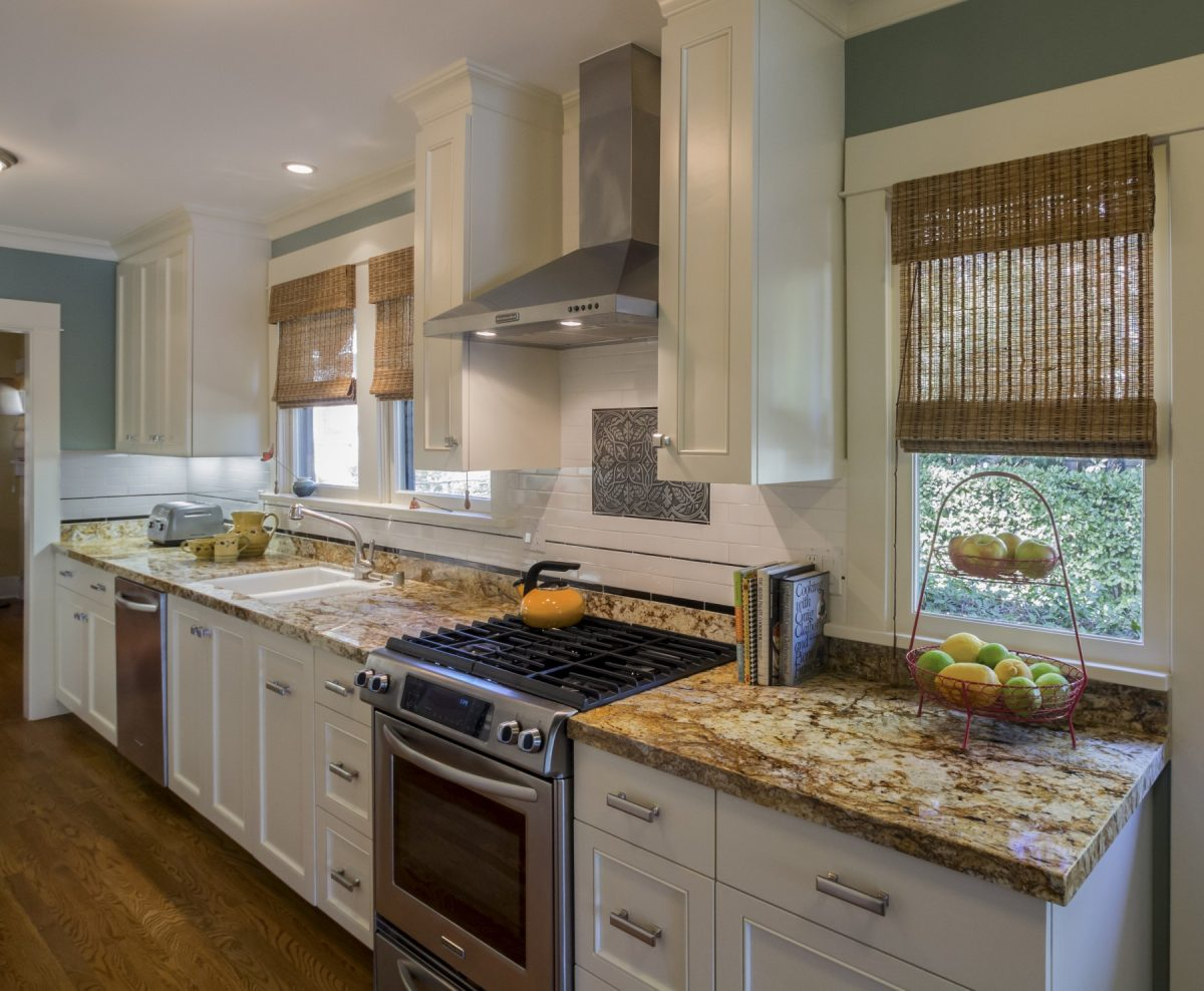 Stainless steel appliances and decorative tiled backsplash