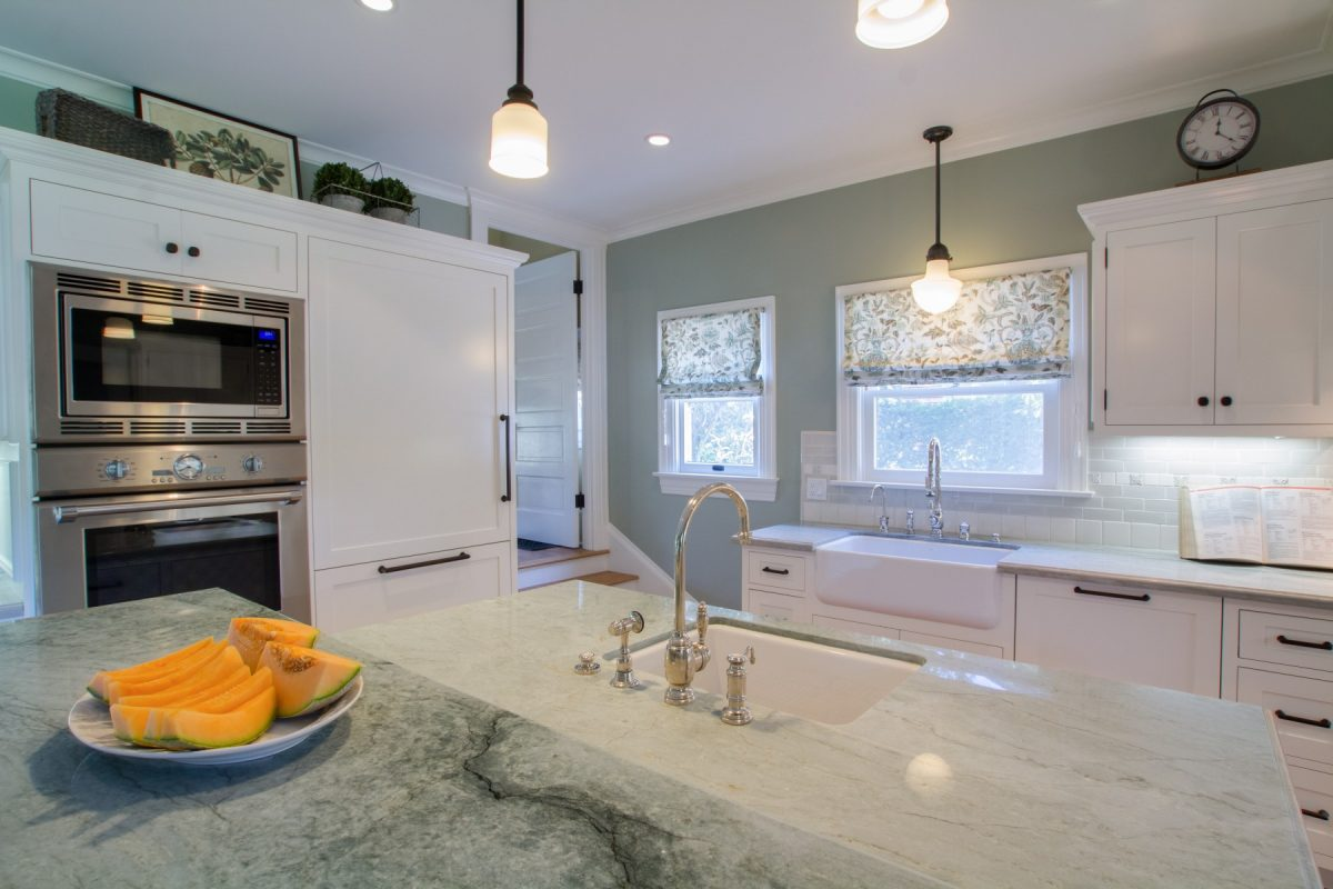 A White Craftsman Kitchen With Sea Pearl Green Quartzite Countertops.