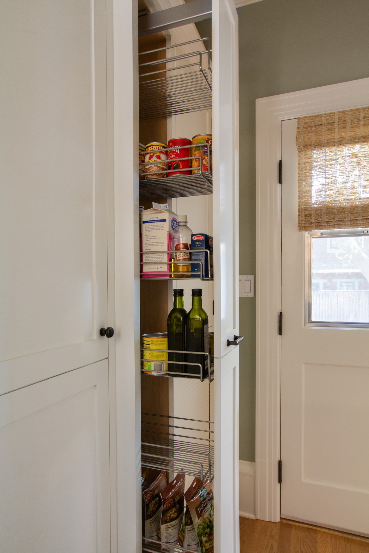 Tall pull-out cabinet off Kitchen