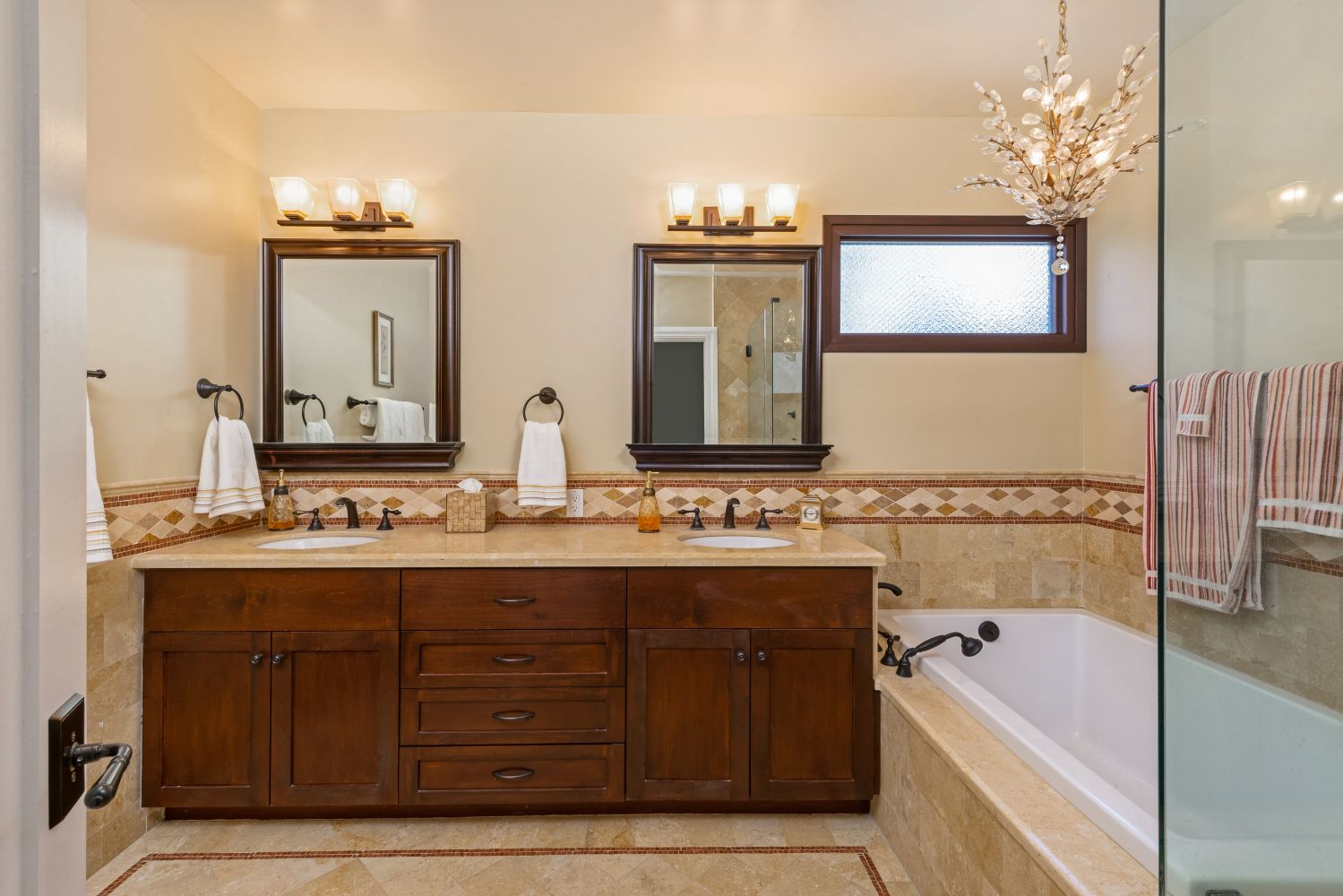 A Master Bath double vanity with decorative tile