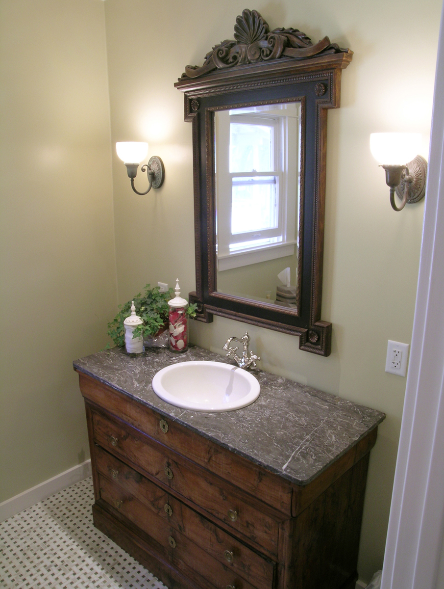 Guest bath with rustic sink and mirror