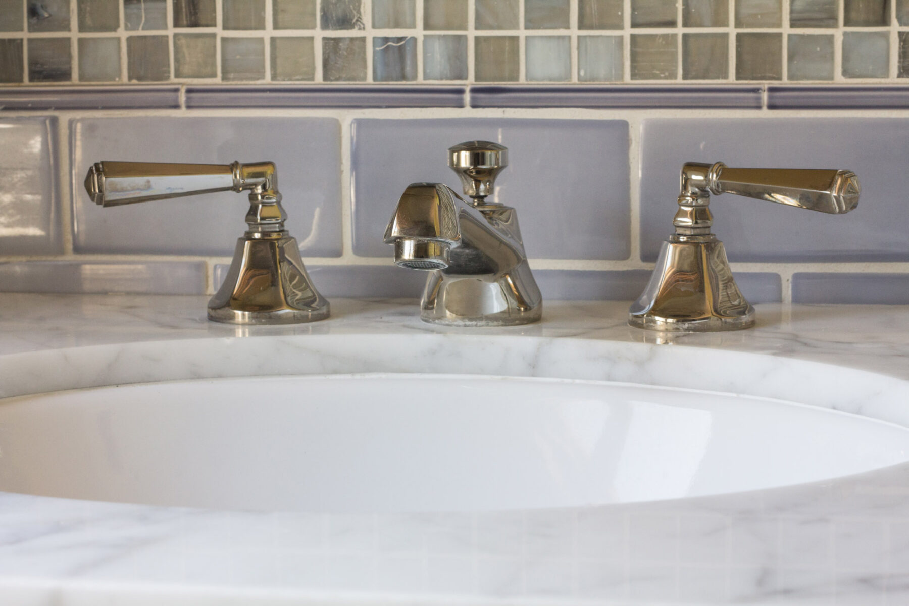 Polished nickel faucets and decorative tile