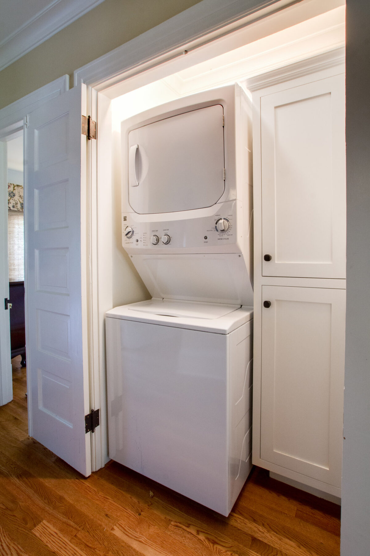 A 2nd floor laundry area with stackable washer/dryer.