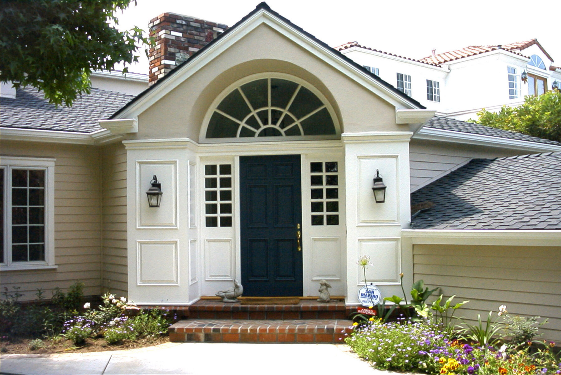 Colonial entry wood work and siding