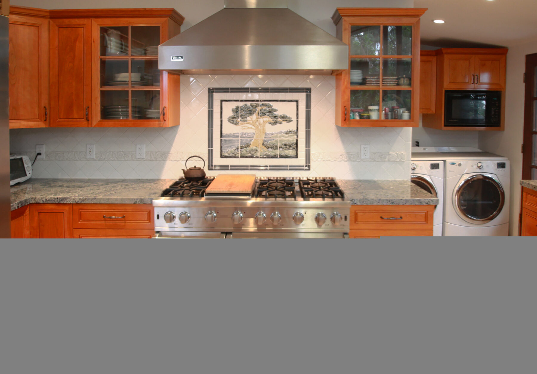 Stainless steel range and hood with Pratt Larson tile