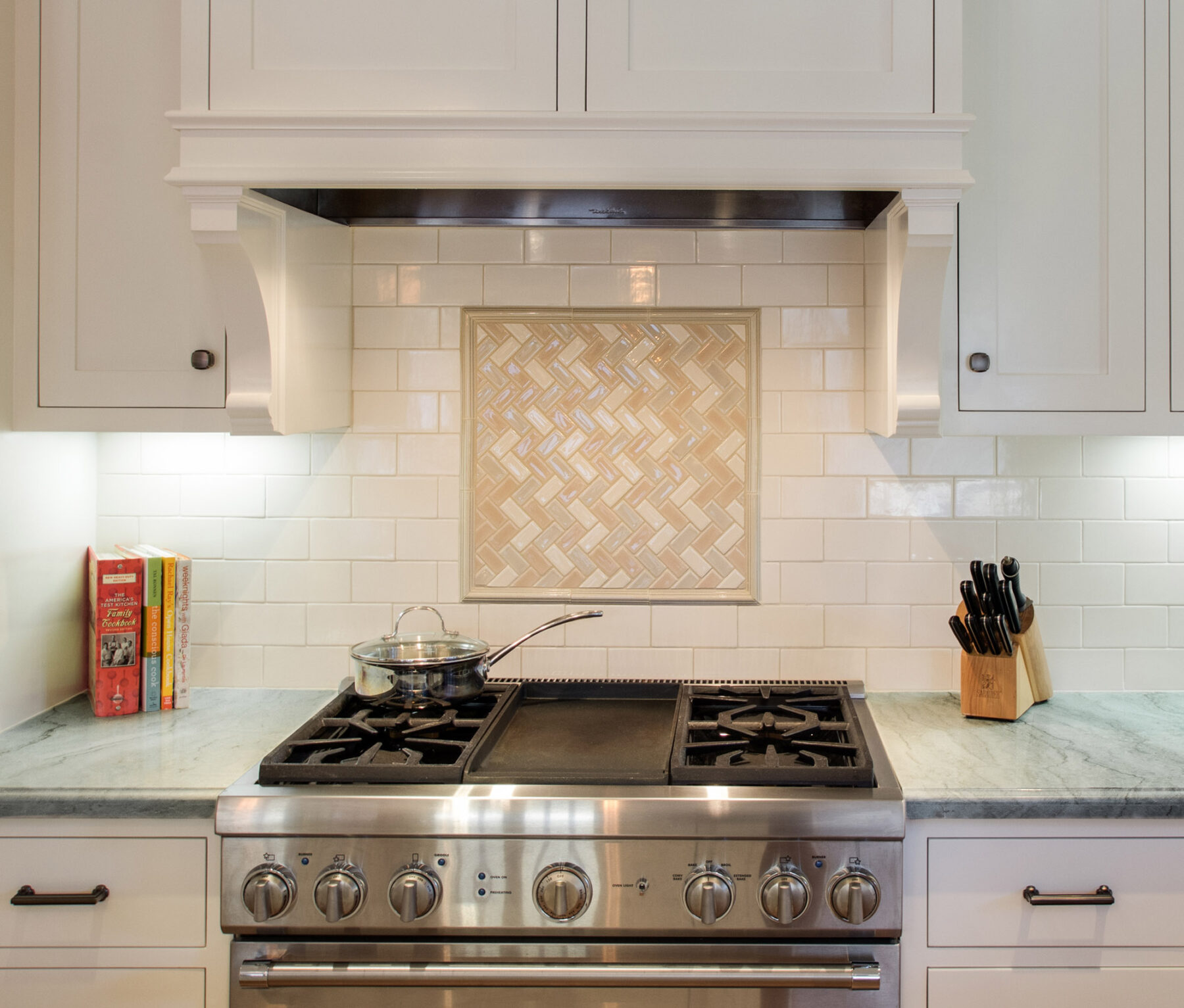 Custom tile backsplash and custom wood hood surround with corbels.