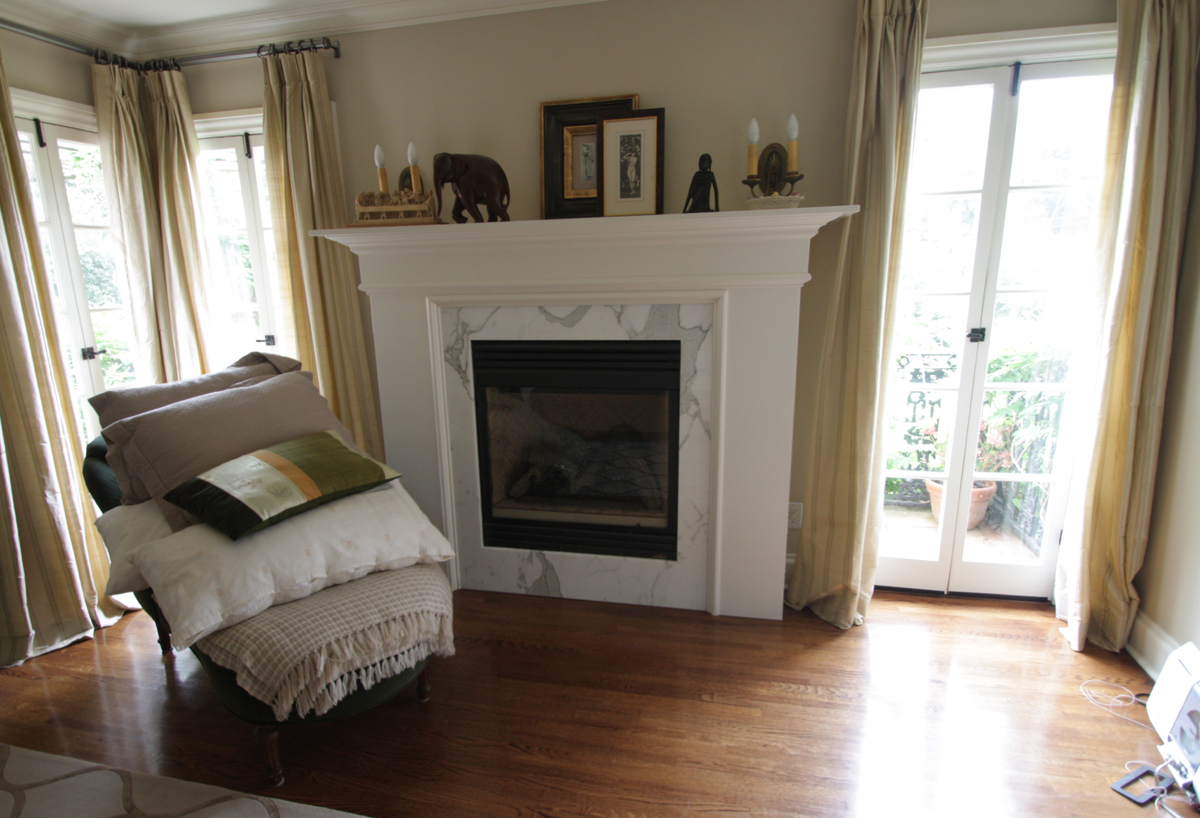Calcutta gold fireplace surround with a Colonial mantle.