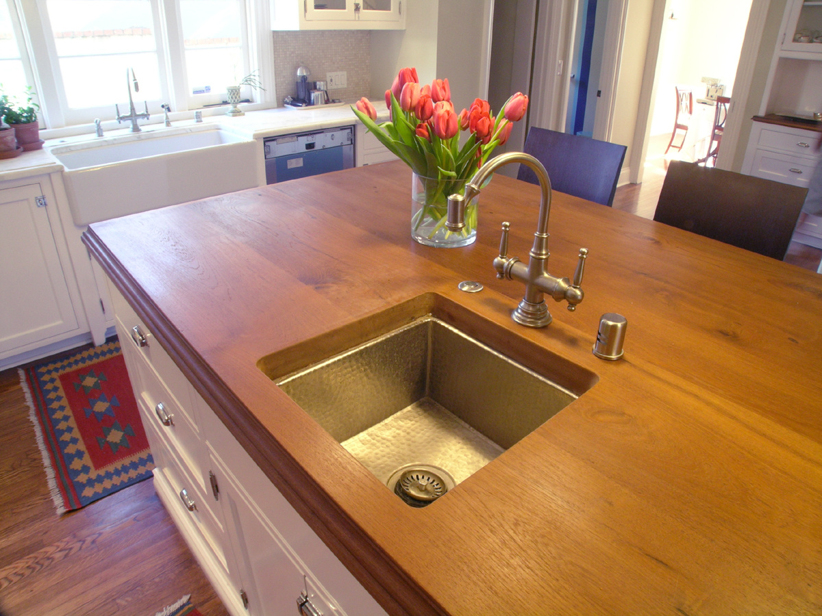 Kitchen island featuring a Teak wood countertop