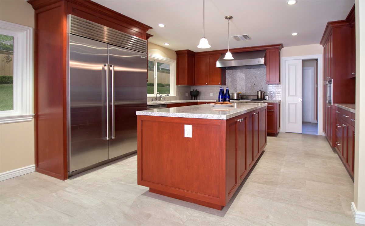 Cherry kitchen with light grey flooring and tile.