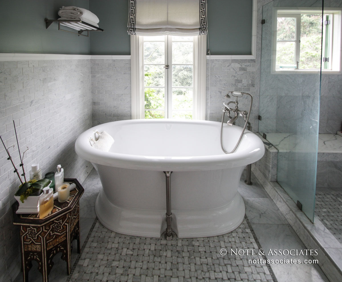 A soaking tub with window view