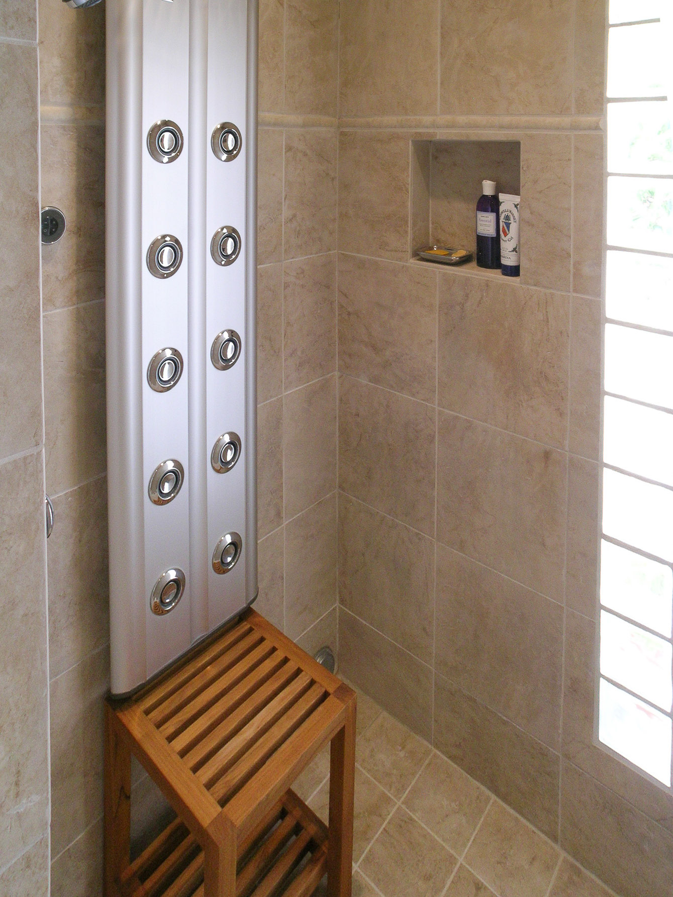 A Full Shower With Waterfall Plumbing Fixture