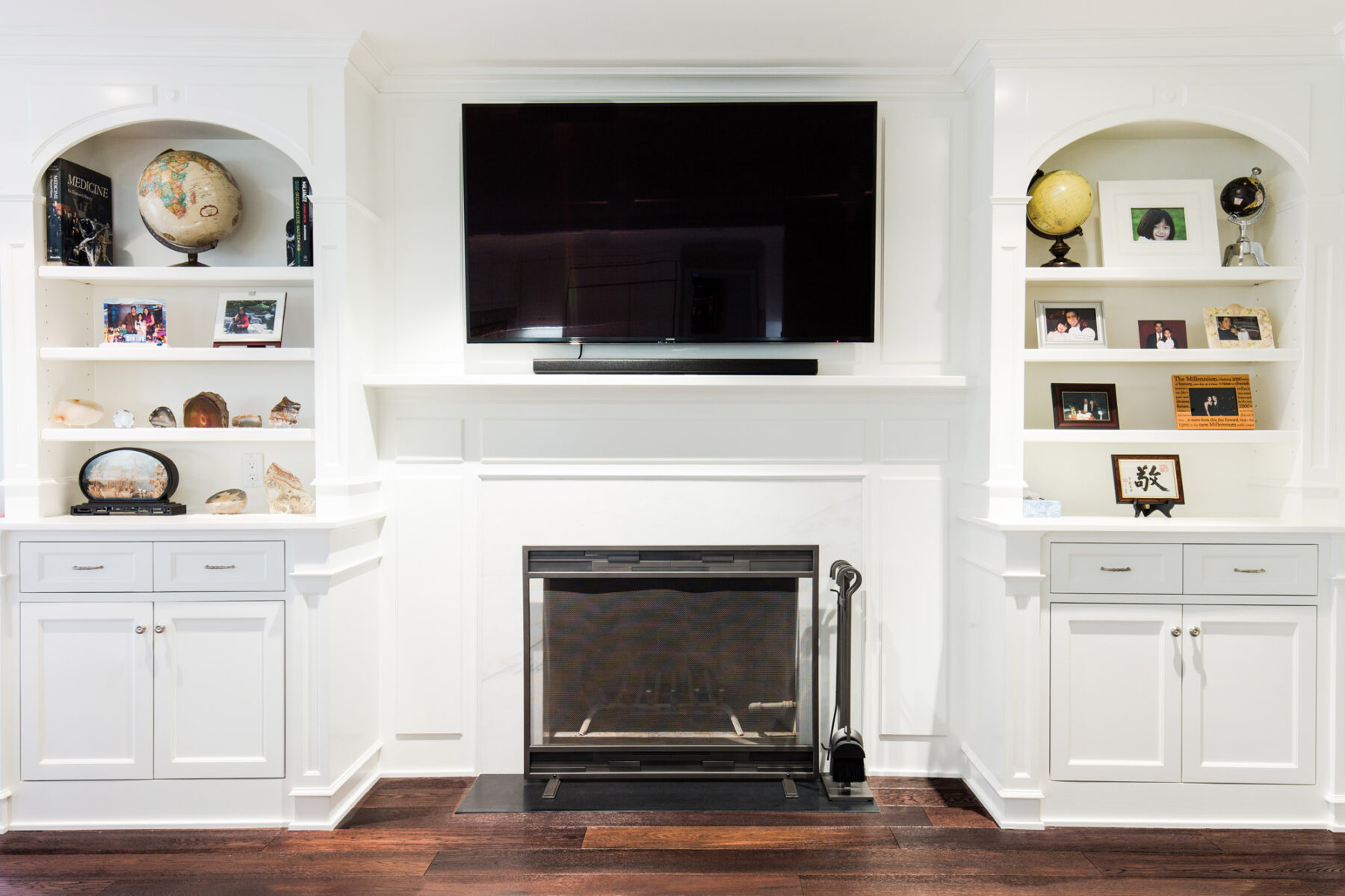 Custom Entertainment Center Over Fireplace With Flanking Bookcases