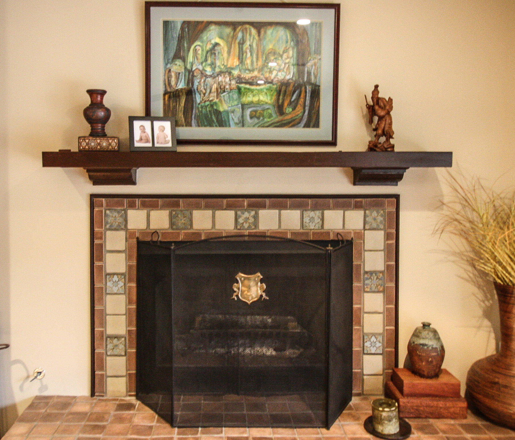 Fireplace With Custom Tile Work And Wood Mantle