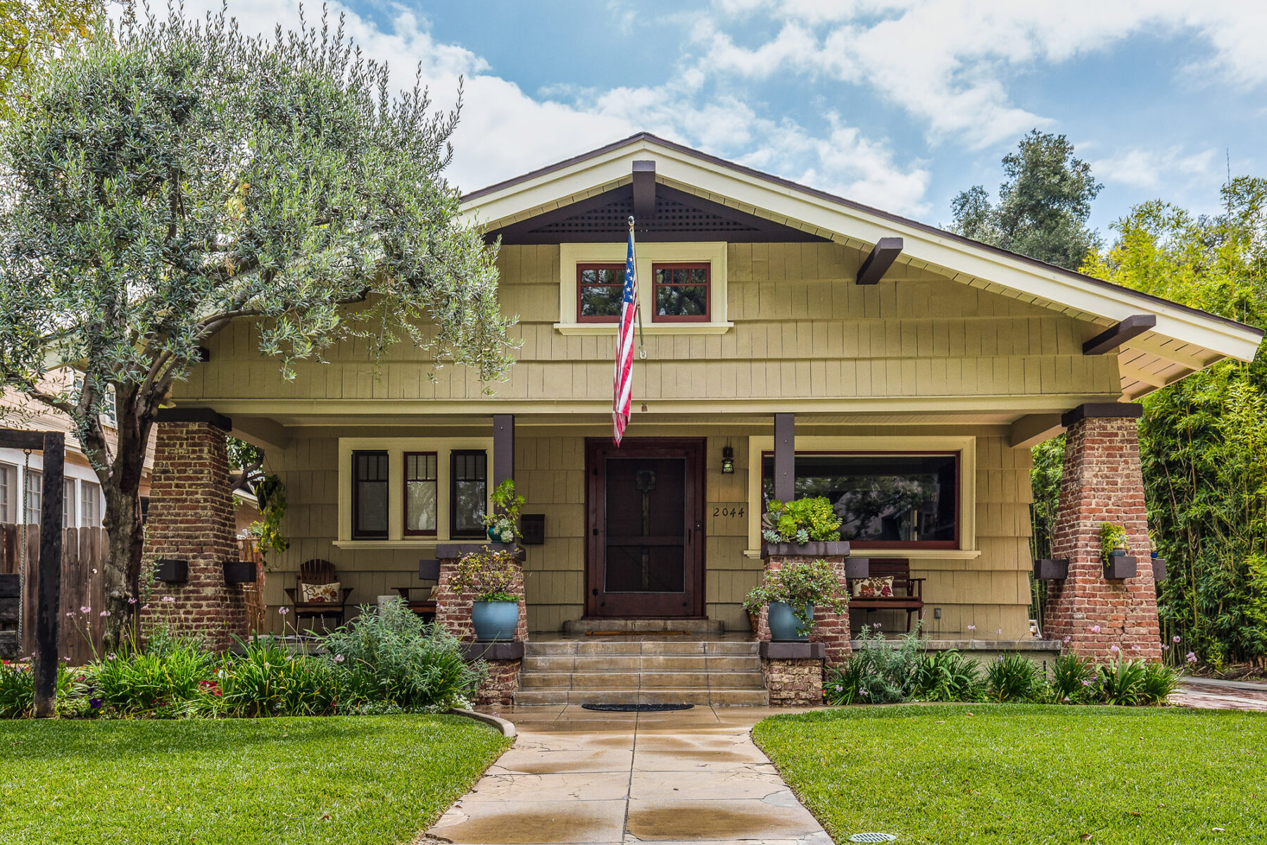Restored Craftsman With Exposed Brick Columns And Accented Wood Work
