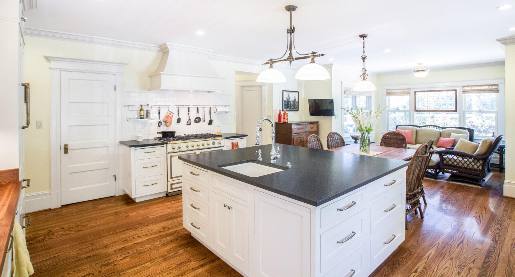 The island with prep sink and new rift cut white oak hard wood floors.