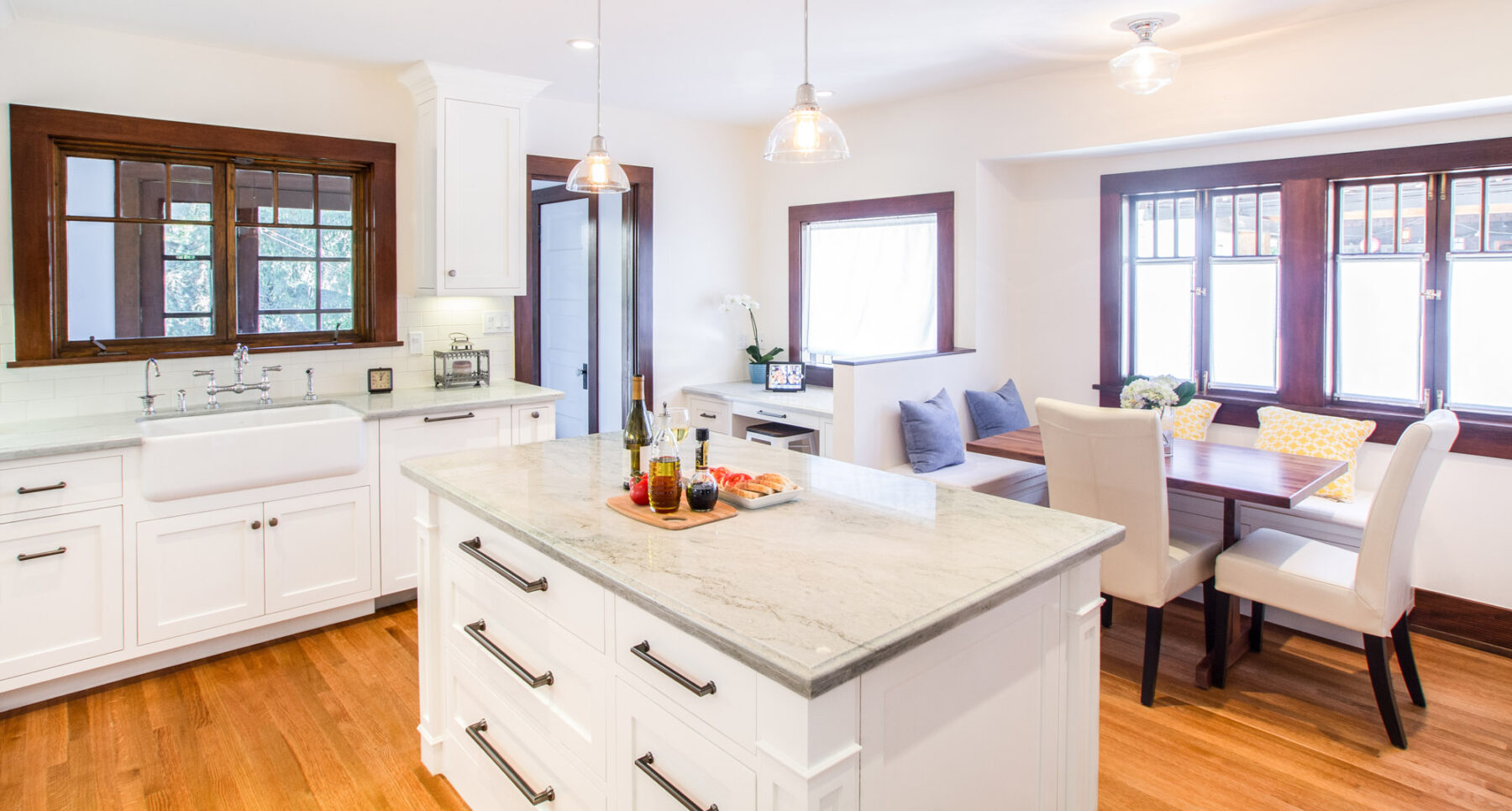 This 1910 Craftsman kitchen remodel in white and period style fixtures