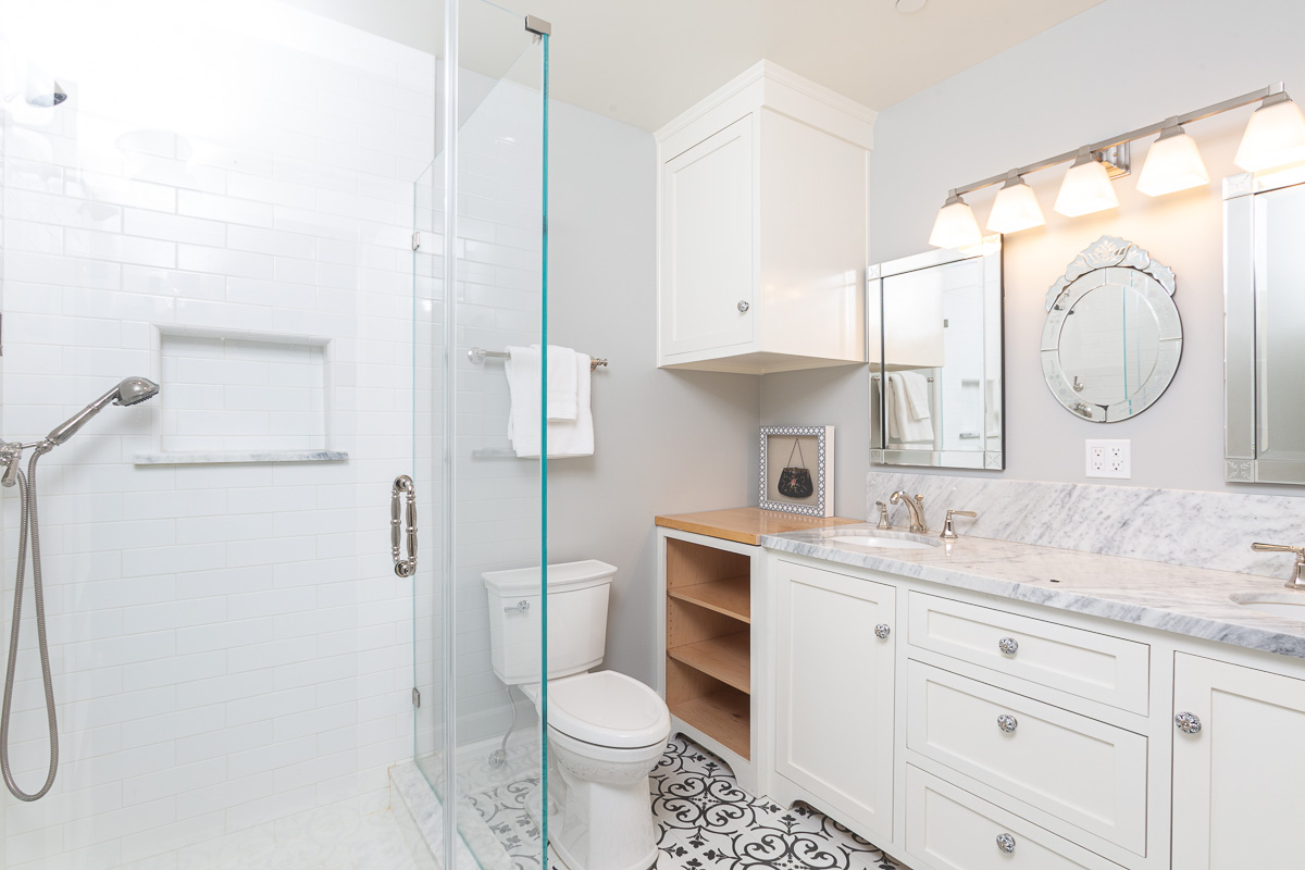 Bathroom With Subway Tile And Carrara Marble Countertop